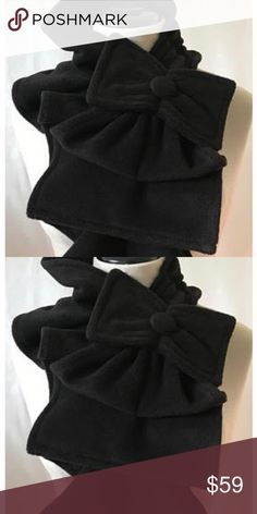 Ruffle Scarf with Bow Detail in Black This is a stunning fleece ruffle scarf with bow detail in black. This is so unique and you will love wearing it with your coat, denim jacket, or just a cute top! More colors and prints available! Accessories Scarves & Wraps