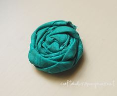 I keep seeing these on everything.  http://www.craftaholicsanonymous.net/2011/07/fabric-rosettes-tutorial.html