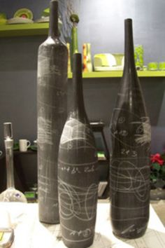 """Turn old wine bottles into chalk art! Just spray them with chalkboard paint. After the paint dries, rub chalk all over the bottle and then erase it. This will """"prime"""" the bottle and give it that old chalkboard look that you so love! Chalkboard Wine Bottles, Old Wine Bottles, Recycled Wine Bottles, Painted Wine Bottles, Wine Bottle Crafts, Liquor Bottles, Glass Bottles, Paint Bottles, Empty Bottles"""