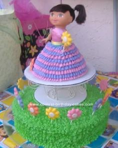 "dora cake- awesome cake idea... it's a ""barbie"" cake with Dora instead!"