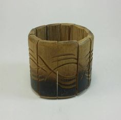 Check out this item in my Etsy shop https://www.etsy.com/listing/243012685/boho-wide-bamboo-carved-bracelet