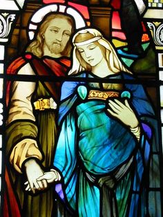 Stained glass window in Kilmore Church on the Isle of Mull, Scotland depicting Jesus and a pregnant woman believed to be Mary Magdalene.