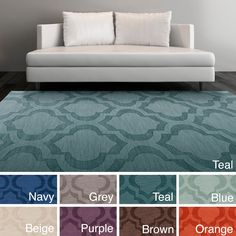 Add bold style to your decor with this tone-on-tone trellis patterned rug. Hand-woven with wool, this 2' x 3' rug will accent any space with its bold colors and trendy design.