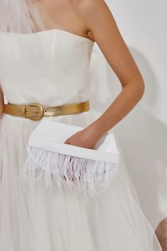 Bring a glamorous edge to your bridal look with the Domna design clutch. This unique and ultra-classy formal handbag is handmade of fine white quality leather and silky feathers. It comes also in buttery soft nubuck in nude/pink. Greek Chic Handmades Women's bags are designed and handcrafted in Athens, Greece from the same premium leather we built the sandals with and the impeccable local craftsmanship. Bridesmaid Clutches, White Clutch, Wedding Clutch, Leather Clutch Bags, Athens Greece, Bridal Looks, Women's Bags, Feathers, Greek