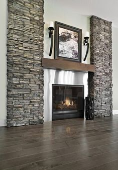 i like the look of this with the rock on the sides of the fireplace. So different from the typical rock fireplaces. Home Fireplace, Fireplace Remodel, Fireplace Surrounds, Fireplace Design, Fireplace Feature Wall, Fireplace Lighting, Fireplace Ideas, Rock Fireplaces, Living Room Remodel