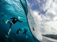 An extraordinary photograph of a surfer and surf photographers on the North Shore of Oahu by Sash Fitzsimmons.
