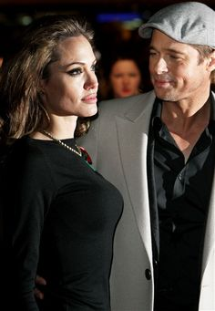 "Brad Pitt gives Angelina Jolie an admiring look at the London premiere of ""Beowulf"" on Nov. 11, 2007."
