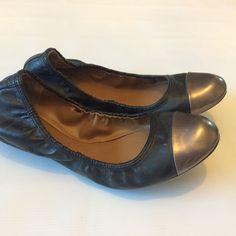 Tahari flats Black flats with bronze cap toes. Great condition! Tahari Shoes Flats & Loafers