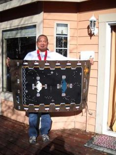 """""""Navajo rug weaver Julius Chavez holds his creation that is based on a ceremonial sand painting. The rug depicts the sun, the moon, the Milky Way and constellations that are important in the Navajo culture. (Scott Iwasaki/Park Record)"""" ... from the 23rd Adopt-A-Native Elder annual Navajo Rug Show"""