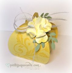 2015 Stamps:  Flowering Flourishes Ink:  Daffodil Delight Paper:  Daffodil Delight, Whisper White, and Wild Wasabi card stock Tools:  Curvy Keepsake Box Die, Big Shot Die Cutting Machine, Pansy Punch, Bird Builder Punch, Stampin' Sponge Daubers Embellishments:  White Jute Ribbon