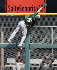 One of two almost identical catches in the first game of spring training 2014. He robbed the Giants of 4 runs!