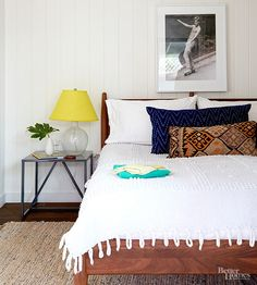 The guest bedroom repeats the vertical white paneling used in the living spaces. Plenty of fun accents dot the restful room, creating a space that is relaxing and inviting./