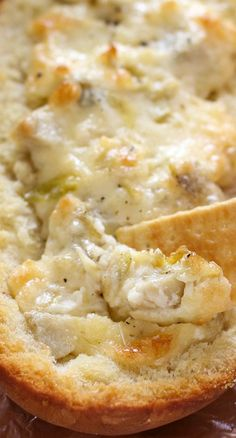 Easy Cheesy Artichoke Dip in a Baguette Recipe ~ It makes the perfect party food, and you'll be amazed by how good it is!