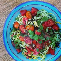 Fresh garden veggies!  Salad consists of two zucchinis, 1 cucumber, a whole bunch of cherry & juliet tomatoes, kale seedlings, arugula seedlings, & wakame seaweed noodles.  Heirloom tomato-basil-garlic dressing.