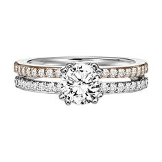 Diamond engagement ring featuring white and rose gold with a round center stone and side stones set on a split shank. style: Jade #ArtCarvedBridal #ArtCarvedPinterest