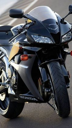Honda CBR 600RR... this is exactly like jons bike only he had a smoked windshield, recessed turn signals, fender eliminator etc.. his baby