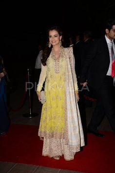 Dia Mirza wore a Manish Malhotra yellow chikankari kalidar suit with wide legged pants and beige dupatta