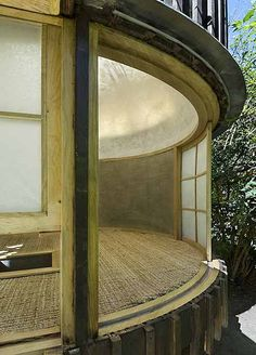 David Maštálka of A1 Architects has collaborated with sculptor Vojtech Bilisic to build a tea house in Prague, Czech Republic. Open to the surrounding gardens on one side, the small structure has a translucent, domed roof covered with paper. It was built using oak and the exterior is clad in burnt larch wood. Photographs by More