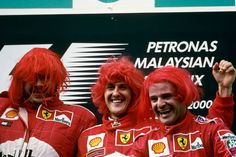 Ross Brawn Michael Schumacher Rubens Barrichello Grand Prix of Malaysia Sepang International Circuit 22 October 2000 Wearing red wigs on the podium