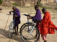 Richard Lees, a friend of mine, did a Unicycle tour thru Africa. Masai Warriors checking out their Unicycles.