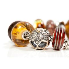 Troll Beads has a divine amber collection - I would like an amber bead