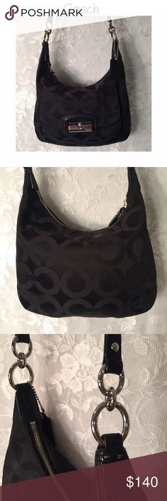"""Authentic Coach bag. Excellent used condition! Signature """"C"""" Coach bag with 2 sizes of shoulder straps. Only used a few times. Has outside pocket for cell phone. Has 2 inside pockets plays a zipper inside pocket. Holds a lot of stuff! Shoulder strap is 12.5"""" Ling shoulder strap is 36"""" plus 6"""" extra! Can be used as a shoulder bag or cross body. Excellent used condition! Coach Bags Shoulder Bags"""