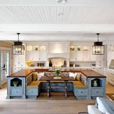 Love this island with inset table & benches! - maybe a smaller scale for the apartment?