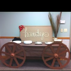 2 wheels and a table with brown table cloth make a wagon - love it