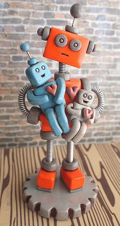 Commission from 2012: Robot Dad holding children robots made by HerArtSheLoves.com via theawesomerobots.com