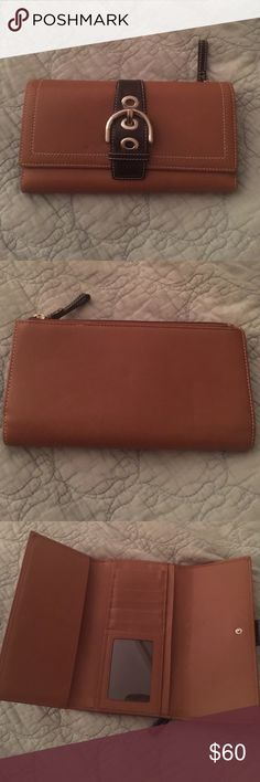 Coach Wallet Authentic Coach wallet. Used a long time ago and I totally forgot I had it! The back shows some indents and one tiiiiiiny black mark, but overall really good condition! Inside is clean. Refer to pics, they're an accurate description of wear! Coach Bags Wallets