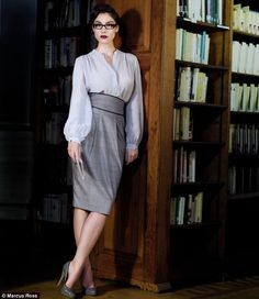 "Is it just the glasses and the book shelves, or does the outfit itself say ""librarian""?"
