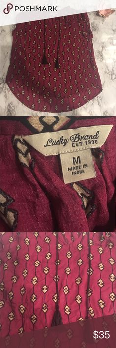 LUCKY BRAND HIGH LOW SHIRT TASSLE TRIBAL PRINT Perfect condition super cute and perfect for everyday wear! Lucky Brand Tops Tees - Short Sleeve