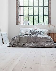 Rustic, industrial, styled bedroom with linen sheets and huge light windows. Love this space