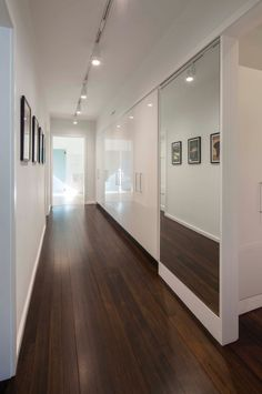 The high gloss white cabinets on one side are for storage and for art work on the other side.