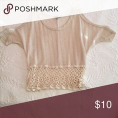 Crop shirt. Tan colored with gold sparkles throughout the whole top. The shoulder are cut out in the sleeves and the bottom portion is a see through design with a tie on the side! Charlotte Russe Tops Crop Tops