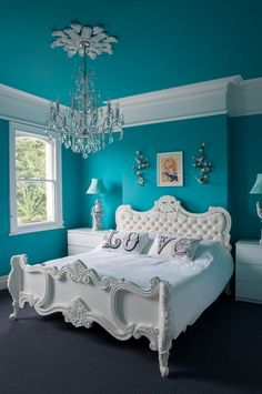 turquoise and white bedroom, pantone biscay bay, caribbean blue, teal, greenish-blue, tufted white headboard, classic bedroom design
