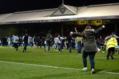 Supporters invade the Firhill pitch at full time as Celtic clinch the title