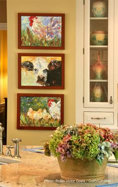 Triple paintings stacked closely - same artist, same theme- fun  Classic Hill Interiors