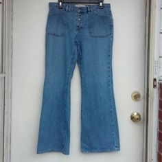 GAP Flare Jeans GAP Flare jeans, size 10. Lighter wash. Four snap closure. Small white spots, looks like bleach maybe, on left front leg by bottom inseam (pictured) barely noticeable. Otherwise perfect!  All offers considered! GAP Jeans