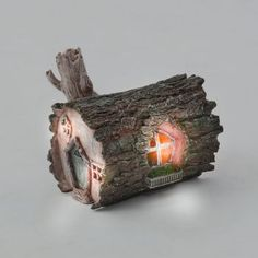Fairy garden: Lit Log Fairy House. From the fairy garden supplies board