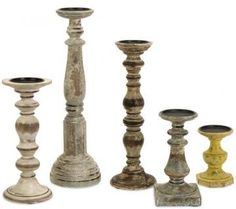 Set of rustic mismatched candleholders, love how they're not all the same shape or color