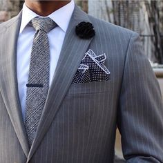 Grey pinstripe suit, with a black and white polka dot pocket square. #classy
