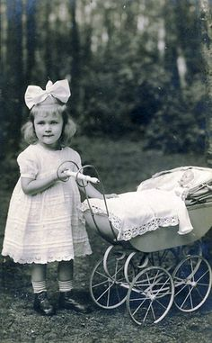 girl with doll vintage photo