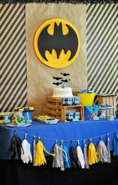 Batman dessert table. featuring a bat cake and the bat signal. This is perfect for a boy's superhero birthday party!