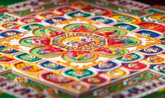 Tibetan Buddhist monks have created sand mandalas for over 2,500 years, as it remains one of the religion's most beautiful and symbolic traditions. Each mandala has a center point that is surrounded by a circle, a perfectly symmetrical design of specific meaning, and an accompaniment of various religious deities and symbols. They are created as…