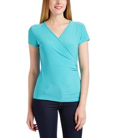 Loving this Turquoise Surplice Tee - Plus Too on #zulily! #zulilyfinds