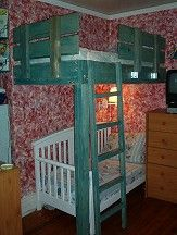 only swap out the pretty white crib with a race car shaped toddler bed, voila' little boy space problem solved:)