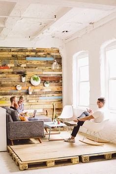 love this pallet wall and the use of pallets to elevate and distinguish a space