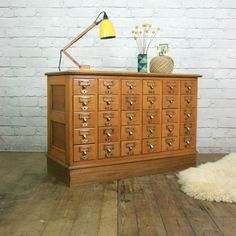 A stunning & very desirable vintage 1930s Library index cabinet, constructed from oak with original solid brass handles.