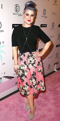 Last Night's Look: Love It or Leave It? | KELLY OSBOURNE | Is this the way to transition the belly chain from summer to fall? Kelly layers one over a black tee and floral Topshop skirt at BeautyCon in L.A., but really, we're all talking about her insane French braid mohawk.